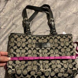 Black coach purse w/ front picket